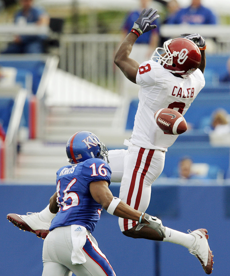 Photo - A pass intended for OU's Brandon Caleb (8) falls incomplete as Chris Harris (16) of Kansas defends during the first half of the college football game between the University of Oklahoma Sooners (OU) and the University of Kansas Jayhawks (KU) on Saturday, Oct. 24, 2009, in Lawrence, Kan. OU won, 35-13. Photo by Nate Billings, The Oklahoman
