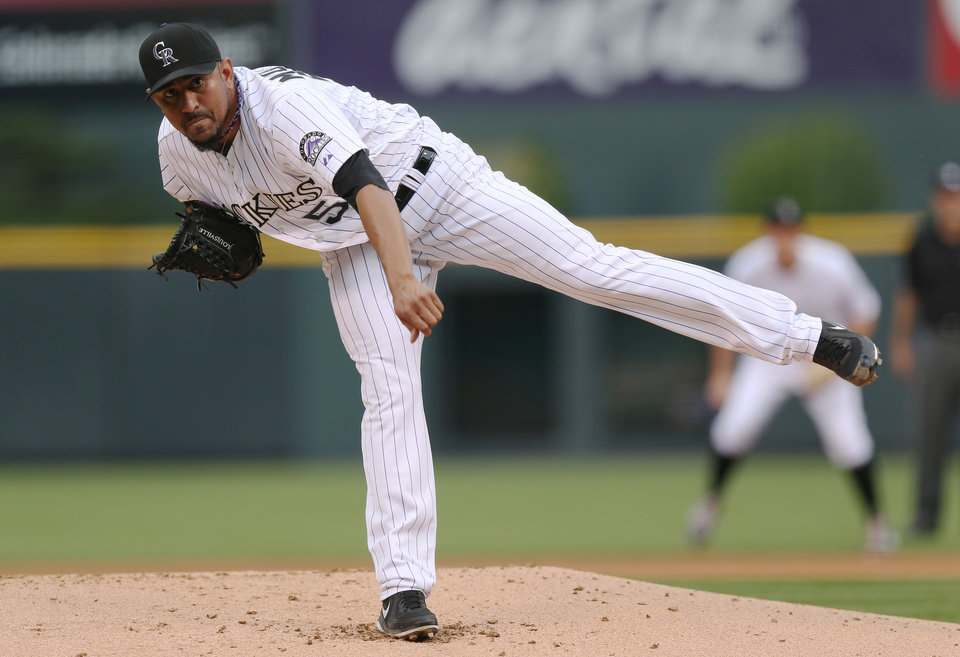 Photo - Colorado Rockies starting pitcher Franklin Morales works against the Los Angeles Dodgers in the first inning of a baseball game in Denver on Thursday, July 3, 2014. (AP Photo/David Zalubowski)