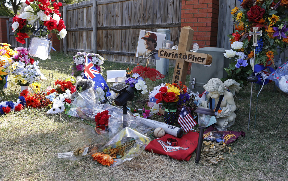 The memorial to Australian Christopher Lane remains at the site where he was killed Aug. 16 in Duncan. Three Duncan teenagers have been charged in the killing. (AP Photo/Sue Ogrocki) <strong>Sue Ogrocki - AP</strong>