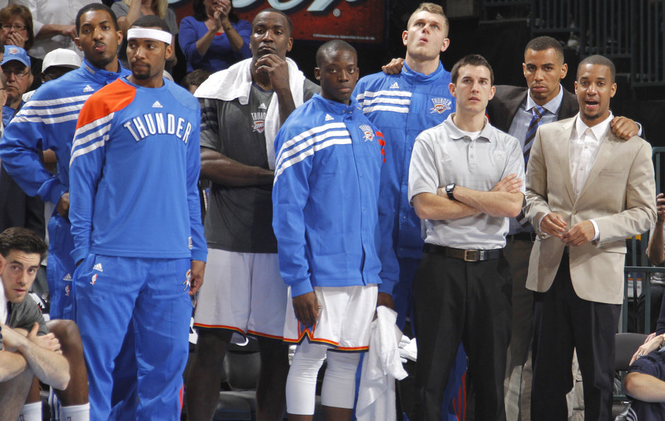 The Thunder bench looks on in the final seconds during the NBA basketball game between the Oklahoma City Thunder and the Phoenix Suns at the Chesapeake Energy Arena on Wednesday, March 7, 2012 in Oklahoma City, Okla.  Photo by Chris Landsberger, The Oklahoman