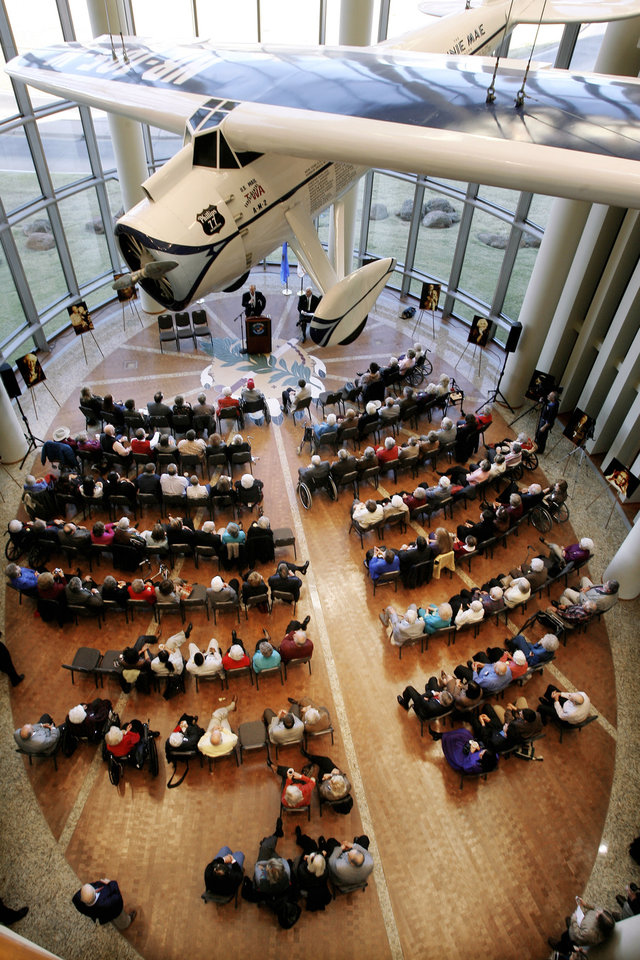 Photo - The crowd, sitting under the Winnie Mae, listens to Willard Scott speak while attending the Centenarian Celebration held at the Oklahoma History Center during Oklahoma Statehood Day in Oklahoma City Friday, Nov. 16, 2007. By Paul B. Southerland, The Oklahoman