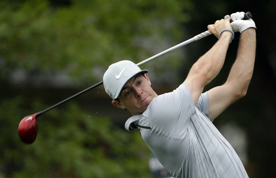 Photo - Rory McIlroy, of Northern Ireland, watches his tee shot on the 10th hole during the second round of the PGA Championship golf tournament at Valhalla Golf Club on Friday, Aug. 8, 2014, in Louisville, Ky. (AP Photo/David J. Phillip)