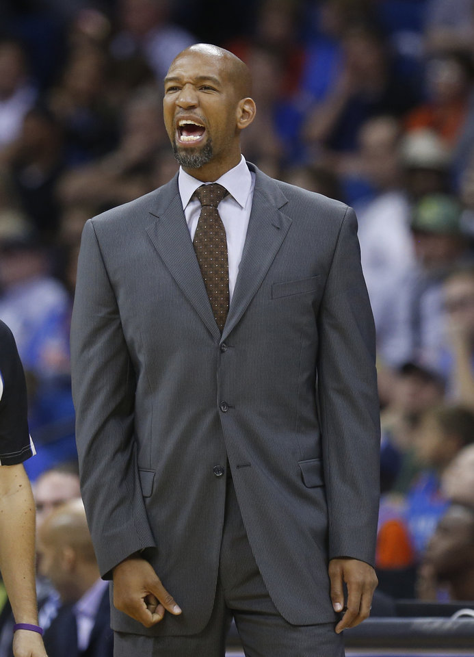 New Orleans Pelicans coach Monty Williams shouts to his team in the fourth quarter of an NBA basketball preseason game against the Oklahoma City Thunder in Tulsa, Okla., Thursday, Oct. 17, 2013. New Orleans won 105-102. (AP Photo/Sue Ogrocki) ORG XMIT: OKSO121