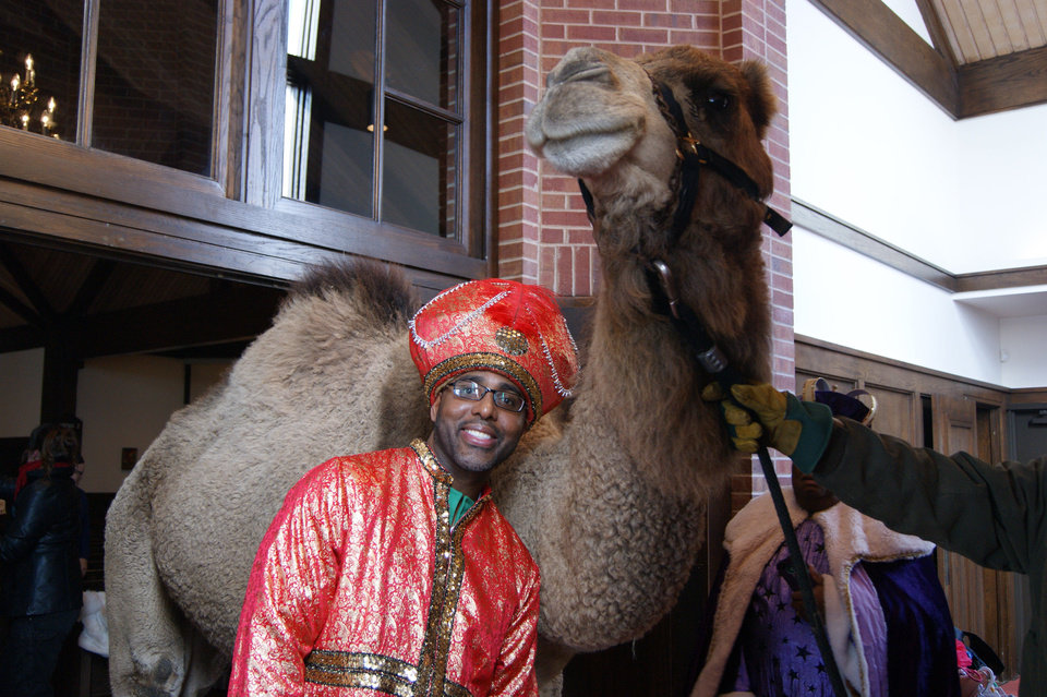 Photo - Bruce Plummer, dressed as one of the Three Wise Men, poses for a picture with one of the camels that took part in the Epiphany service at St. Augustine of Canterbury Episcopal Church in Oklahoma City. Photo provided by Crystal Plummer