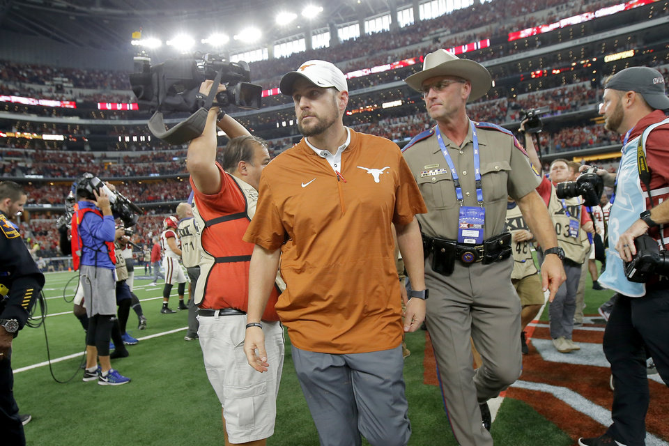 Photo - Texas coach Tom Herman walks off the field after the Big 12 Championship football game between the Oklahoma Sooners (OU) and the Texas Longhorns (UT) at AT&T Stadium in Arlington, Texas, Saturday, Dec. 1, 2018.  Oklahoma won 39-27. Photo by Bryan Terry, The Oklahoman