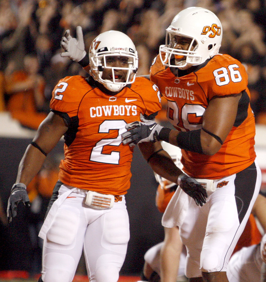 Photo - OSU's Beau Johnson (2) and Wilson Youman (86) celebrate an OSU touchdown during the college football game between the Oklahoma State University Cowboys (OSU) and the University of Texas Longhorns (UT) at Boone Pickens Stadium in Stillwater, Okla., Saturday, Oct. 31, 2009. Photo by Sarah Phipps, The Oklahoman