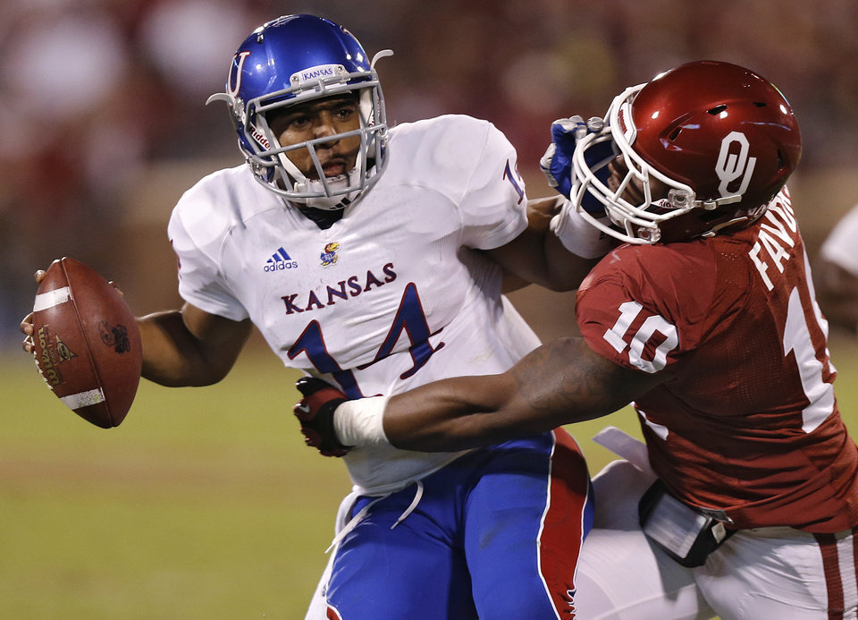 OU\'s Rashod Favors (10) sacks KU\'s Michael Cummings (14) during the college football game between the University of Oklahoma Sooners (OU) and the University of Kansas Jayhawks (KU) at Gaylord Family-Oklahoma Memorial Stadium on Saturday, Oct. 20th, 2012, in Norman, Okla. Photo by Chris Landsberger, The Oklahoman