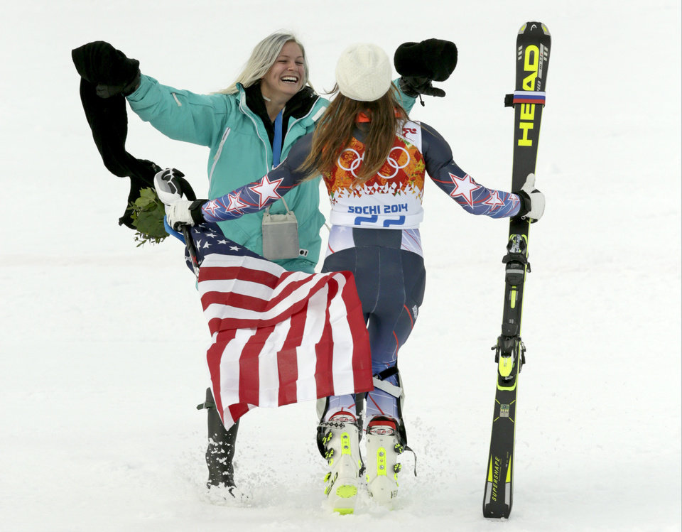 Photo - United States' Julia Mancuso celebrates her bronze medal win in the women's supercombined with her sister, Sara, at the Sochi 2014 Winter Olympics, Monday, Feb. 10, 2014, in Krasnaya Polyana, Russia. (AP Photo/Charles Krupa)