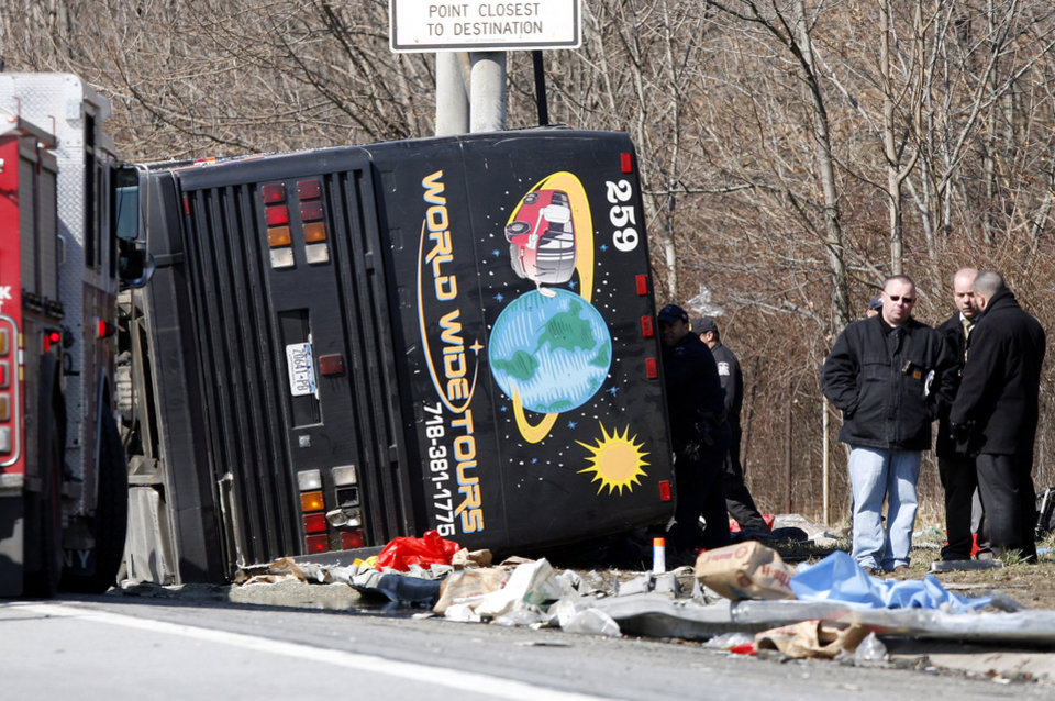 FILE - In this March 12, 2011 file photo, emergency personnel investigate the scene of a bus crash on Interstate 95 in the Bronx borough of New York. Prosecutors in New York alleged the driver, Ophadell Williams, was all but asleep at the wheel, but a jury decided there was not enough proof to convict him. Although police can prove that someone is under the influence of drugs or alcohol while behind the wheel, proving a person to be too fatigued to drive is not as easy. (AP Photo/David Karp, File)
