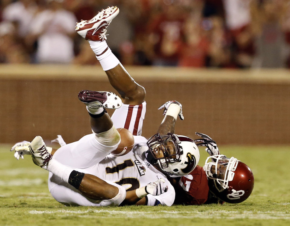 Oklahoma receiver Trey Metoyer loses possession of the football, which was subsequently intercepted by ULM's Cordero Smith in Saturday's game. PHOTO BY STEVE SISNEY, THE OKLAHOMAN