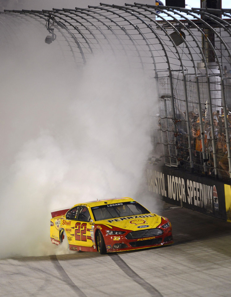 Photo - Joey Logano celebrates his win in a NASCAR Sprint Cup Series auto race at Bristol Motor Speedway on Saturday, Aug. 23, 2014, in Bristol, Tenn. (AP Photo/The Bristol Herald-Courier, Andre Teague)