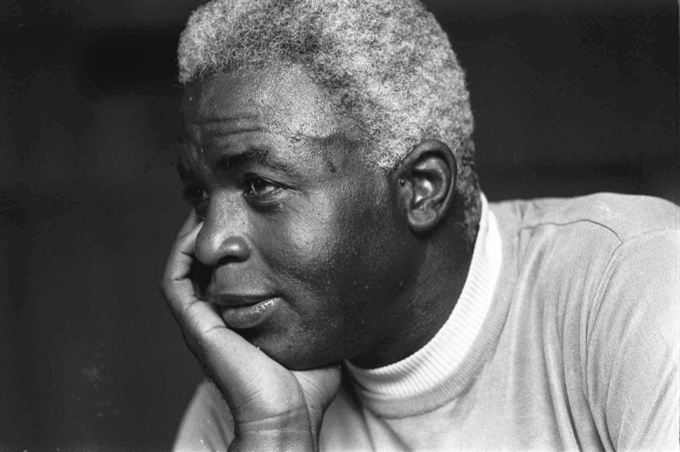 Photo - FILE - In this June 30, 1971 file photo,  Jackie Robinson poses at his home in Stamford, Conn. Kansas City's Negro Leagues Baseball Museum is hosting an advance screening of an upcoming movie about Robinson, who broke major league baseball's color barrier. Thomas Butch of the financial firm Waddell and Reed announced Wednesday, March 20, 2013 that actors Harrison Ford and Andre Holland will be among those appearing at an April 11 screening of