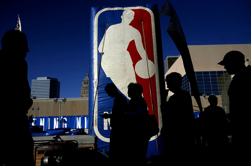 OKLAHOMA CITY THUNDER / NBA BASKETBALL TEAM / REGULAR SEASON OPENING NIGHT: Thunder fans walk around outside the Ford Center prior to the first Oklahoma City Thunder game in downtown Oklahoma City on Wednesday, October 29, 2008. By John Clanton, The Oklahoman  ORG XMIT: KOD
