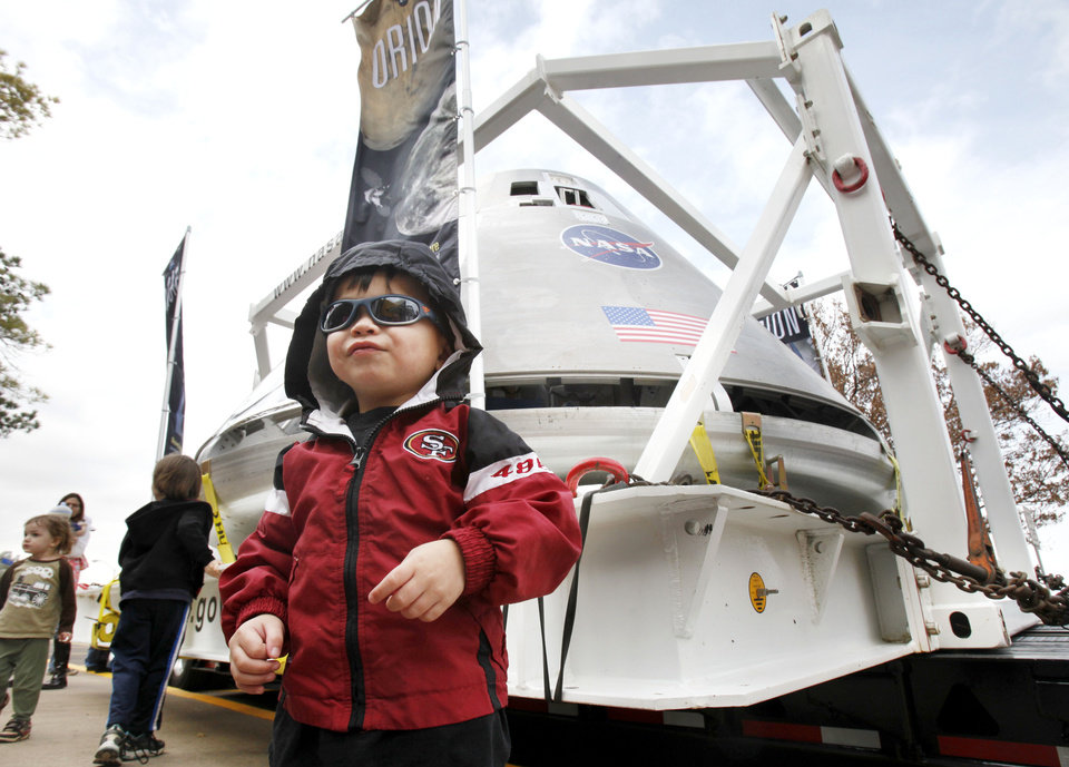 Two-year-old Andrew McGuire stands in front of the test version of NASA's Orion spacecraft which is on display in the parking lot of the Oklahoma Science Museum in Oklahoma City, OK, Tuesday, Jan. 24, 2012. By Paul Hellstern, The Oklahoman