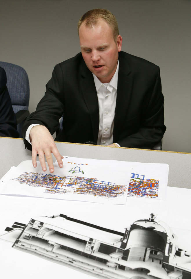 Photo -  Brian Sauer, Director of Mechanical Engineering for FSB, and part of a team of architects and engineers producing a 3D map of the State Capitol, demonstrates various maps of state Capitol in Oklahoma City, OK, Friday, May 29, 2015. The results of the mapping will be used to guide the Capitol's biggest-ever remodel and repair project. Photo by Paul Hellstern, The Oklahoman   PAUL HELLSTERN -  Oklahoman