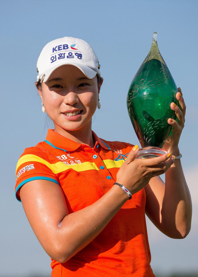 Photo - Hee Young Park, of South Korea, holds the trophy after her victory in the Manulife Financial LPGA Classic golf tournament in Waterloo, Ontario, Sunday, July 14, 2013. (AP Photo/The Canadian Press, Geoff Robins)