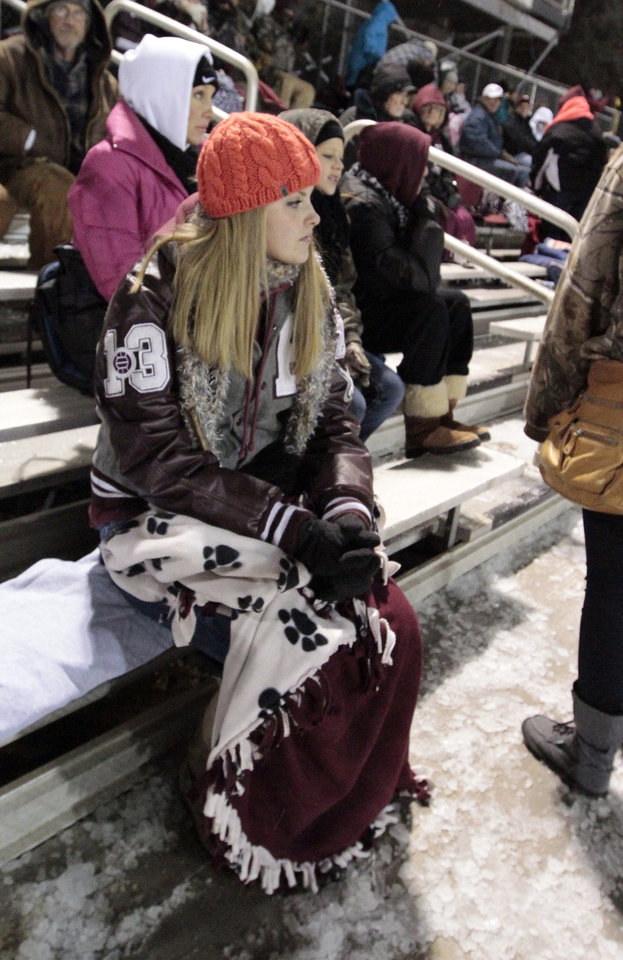 Photo - Brooklyn Stewart dresses for the weather as she watches her brother Tim Stewart play for the Blanchard Lions as Newcastle plays Blanchard in Class 3A high school football playoffs on Friday, Nov. 22, 2013, in Blanchard, Okla. Photo by Steve Sisney, The Oklahoman