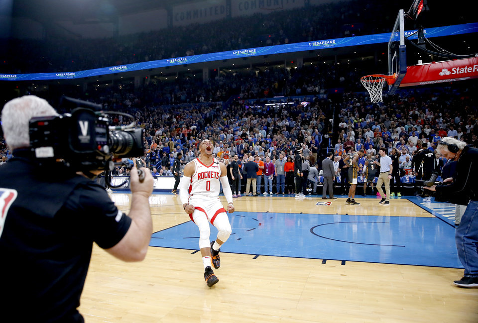 Photo - Houston's Russell Westbrook (0) cheer before the NBA basketball game between the Oklahoma City Thunder and the Houston Rockets at the Chesapeake Energy Arena in Oklahoma City,  Thursday, Jan. 9, 2020.  [Sarah Phipps/The Oklahoman]