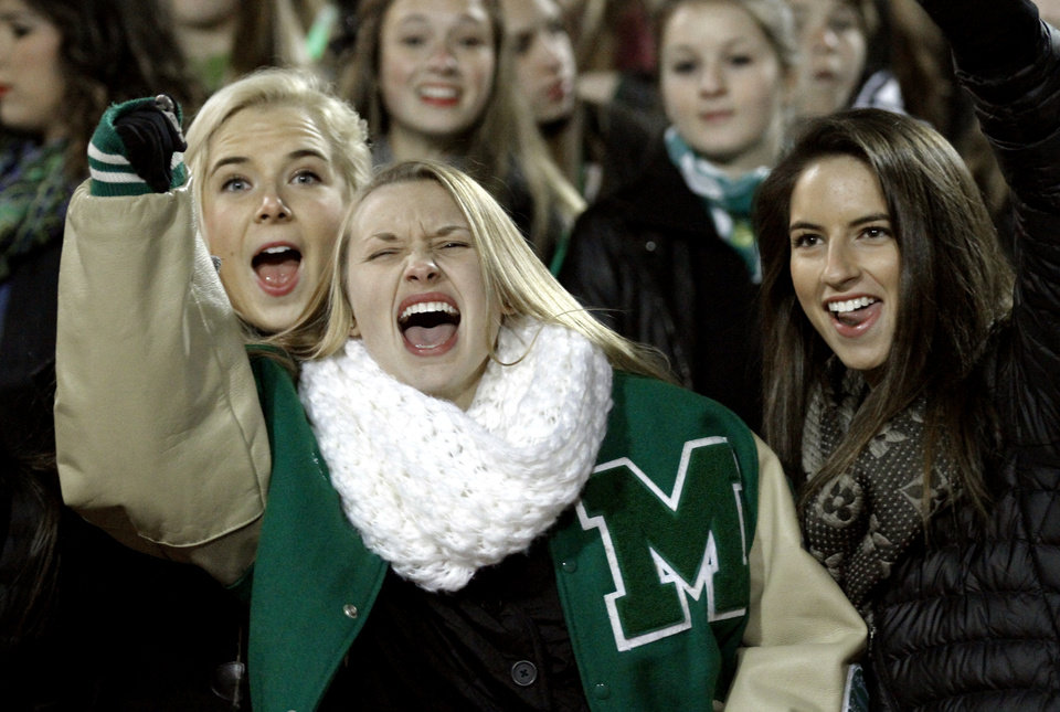 Photo - McGuinness fans Grace Amundsen, Jorden Stephens and Hayden TYerlip cheer as the Bishop McGuinness Irish play the Carl Albert Titans in a Class 5A semi-final playoff game at Harve Collins Field on Friday, Nov. 23, 2012  in Norman, Okla. Photo by Steve Sisney, The Oklahoman