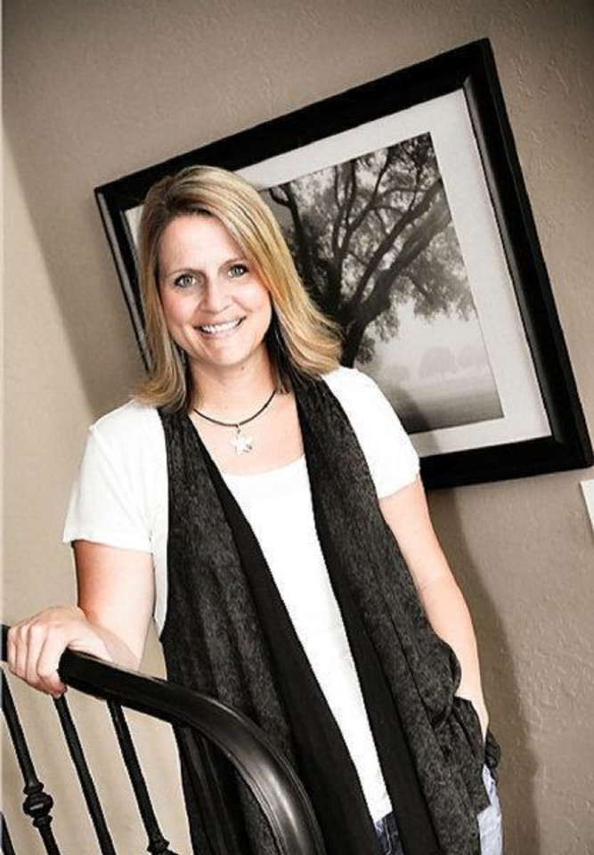 Photo - Cindy Beall poses in the family home shared with her husband, Chris Beall, a pastor and recovered addict.  Provided