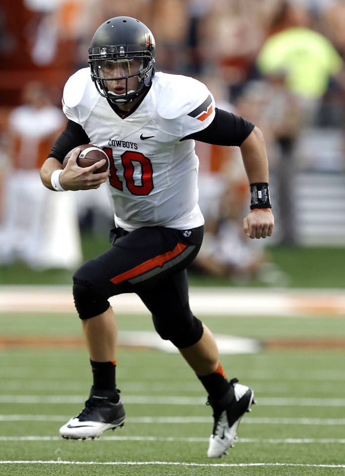 Oklahoma State's Clint Chelf (10) rushes in the third quarter during a college football game between the Oklahoma State University Cowboys (OSU) and the University of Texas Longhorns (UT) at Darrell K Royal - Texas Memorial Stadium in Austin, Texas, Saturday, Nov. 16, 2013. Photo by Sarah Phipps The Oklahoman