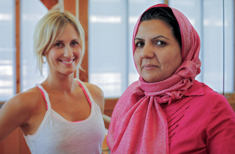 Photo - Afghan student Kobra Dastgirzada, right, poses for a photo with her mentor Andrea Mason at Barre3. The mentorship is part of the Peace Through Business program of the Institute for Economic Empowerment of Women (IEEW). Photo by Chris Landsberger, The Oklahoman.  CHRIS LANDSBERGER - CHRIS LANDSBERGER