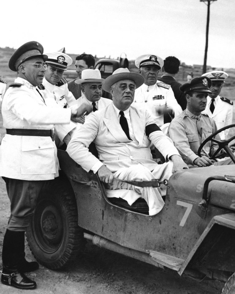 Photo - FILE- In this Feb. 1, 1943, file photo, provided by the U.S. Army Air, President Franklin D. Roosevelt and President Getulio Vargas of Brazil in rear seat wearing white hat pause on their inspection tour of Brazil's army, navy and air forces in Natal, Brazil. Mr. Roosevelt stopped in Brazil en route home from Casablanca. (AP Photo/U.S. Army Air, File)