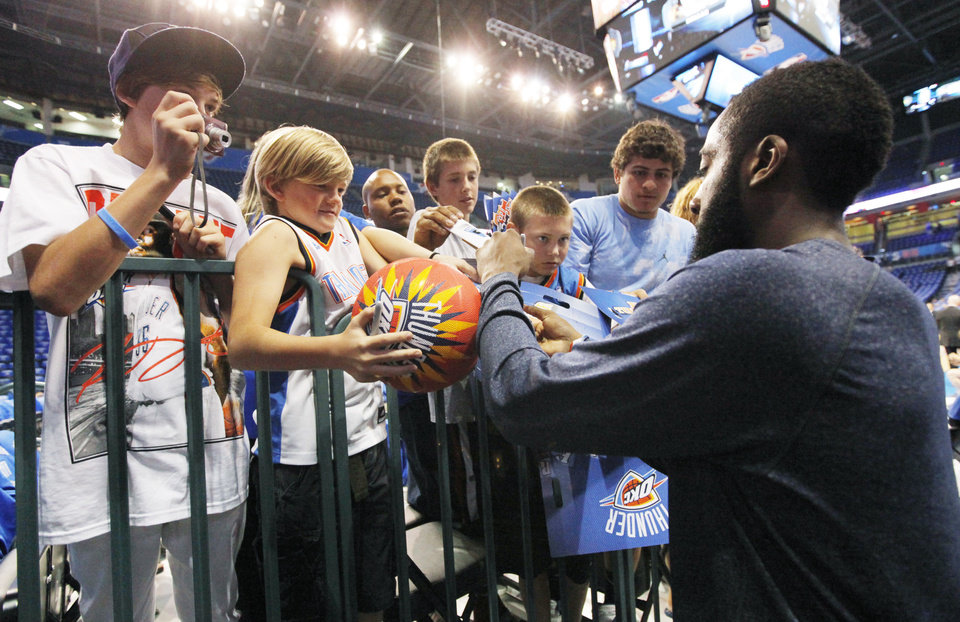 Photo - Oklahoma City's James Harden (13) signs autographs before game 4 of the Western Conference Finals in the NBA basketball playoffs between the Dallas Mavericks and the Oklahoma City Thunder at the Oklahoma City Arena in downtown Oklahoma City, Monday, May 23, 2011. Photo by Nate Billings, The Oklahoman