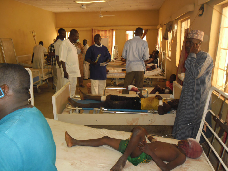 "Photo - Victims of a suicide bomb explosion at a World Cup viewing center receive treatment at Sani Abacha specialist hospital  in Damaturu, Nigeria,  Wednesday, June 18, 2014. An explosion at an illegal World Cup viewing site in Damaturu northeast Nigeria killed at least 14 people while security forces arrested a ""terror kingpin"" among nearly 500 people detained as suspected terrorists in the southeast of the country, in another signal that Nigeria's Islamic uprising is spreading. Police said at least 26 people were wounded in Tuesday night's blast as soccer fans were viewing the Brazil-Mexico match in Damaturu, capital of Yobe state. (AP Photo/Adamu Adamu)"