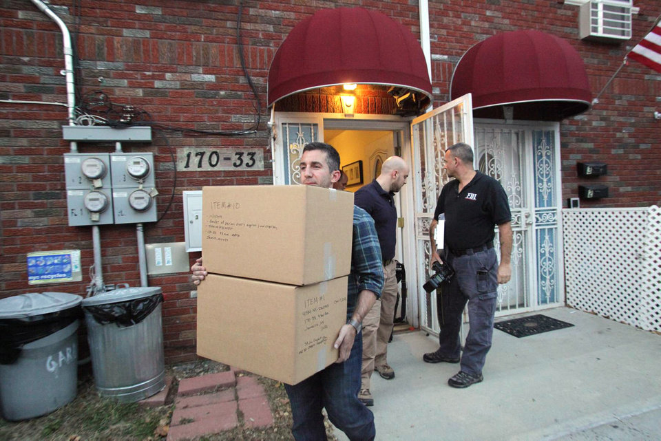 Photo -   Law enforcement officials remove boxes of potential evidence from the New York home where Quazi Mohammad Rezwanul Ahsan Nafis was staying, Wednesday, Oct. 17, 2012. Nafis was arrested in an FBI sting operation earlier in the day after attempting to blow up a fake car bomb outside the Federal Reserve building in Manhattan, authorities said. (AP Photo/Newsday, Howard Schnapp) NYC OUT; NO SALES