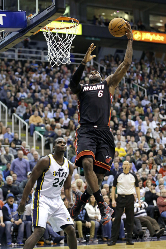 Miami Heat orward LeBron James (6) goes to the basket as Utah Jazz  forward Paul Millsap (24) looks on in the second quarter during an NBA basketball game Monday, Jan. 14, 2013, in Salt Lake City.  (AP Photo/Rick Bowmer)