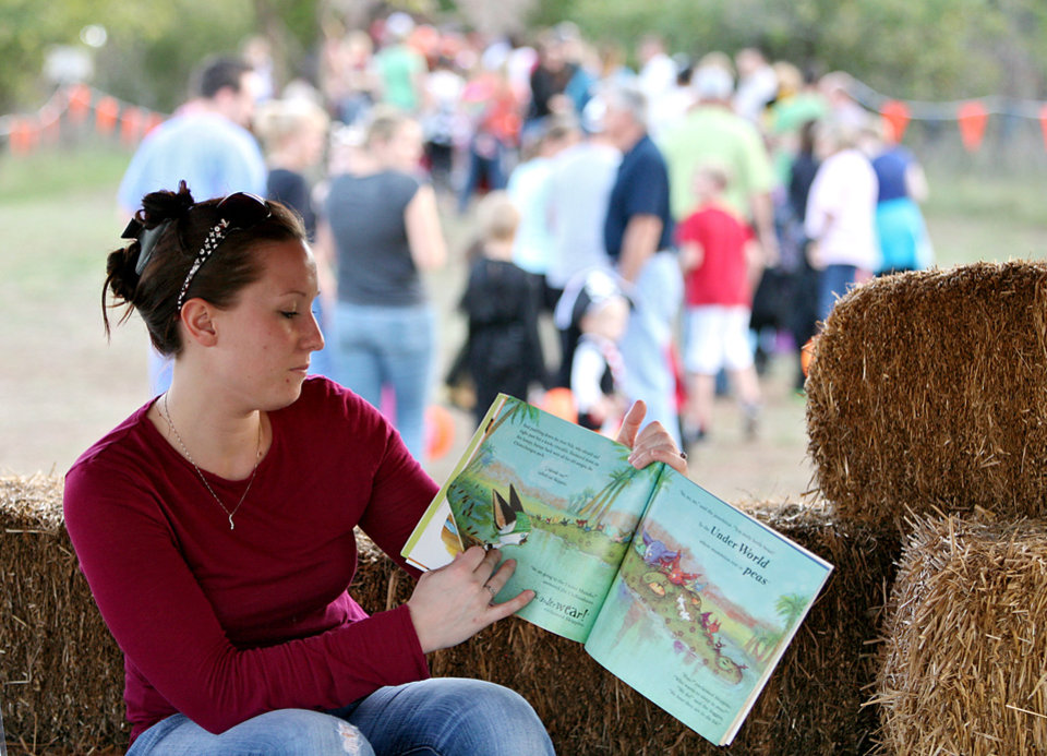 Kathleen Davis, a volunteer and student at UCO, reads a book to children at Story Book Forest at Arcadia Lake in Edmond on Tuesday, Oct. 25, 2011. Photo by John Clanton, The Oklahoman