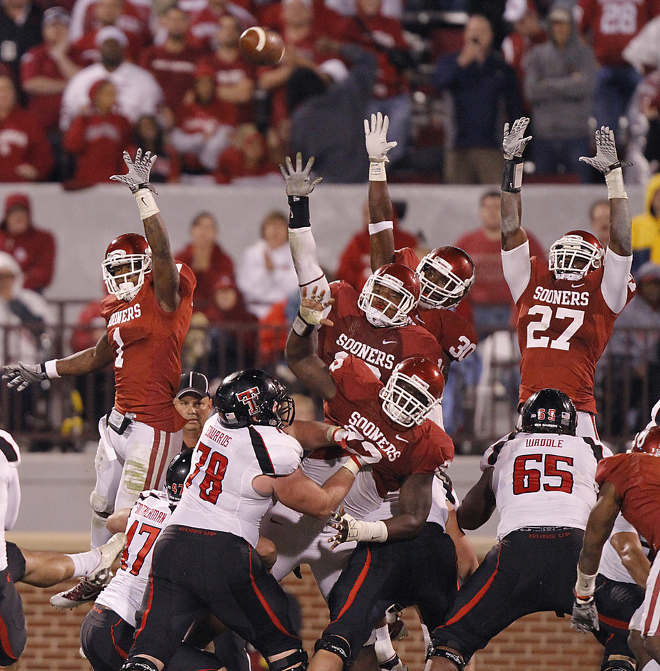 Photo - The Sooners try to block a field goal attempt by Texas Tech during the college football game between the University of Oklahoma Sooners (OU) and Texas Tech University Red Raiders (TTU) at the Gaylord Family-Oklahoma Memorial Stadium on Saturday, Oct. 22, 2011. in Norman, Okla. Photo by Chris Landsberger, The Oklahoman