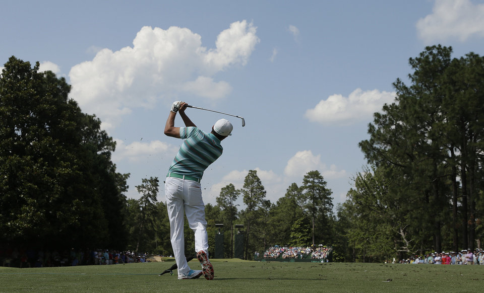 Photo - Rickie Fowler watches his tee shot on the ninth hole during the third round of the U.S. Open golf tournament in Pinehurst, N.C., Saturday, June 14, 2014. (AP Photo/Charlie Riedel)