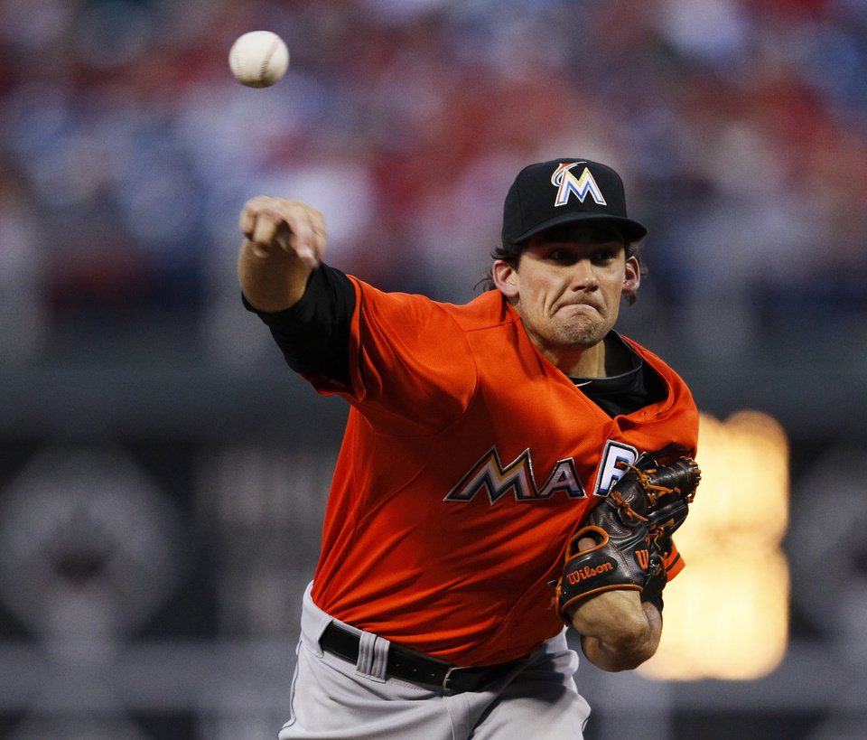 Photo - Miami Marlins' Nathan Eovaldi throws during the first inning of a baseball game against the Philadelphia Phillies, Saturday, April 12, 2014, in Philadelphia. (AP Photo/Tom Mihalek)