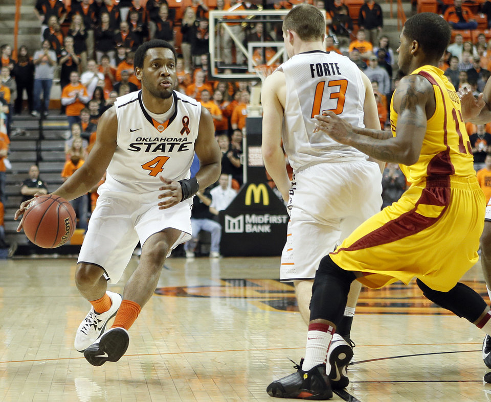 Photo - Oklahoma State's Brian Williams (4) drives the ball during the college basketball game between the Oklahoma State University Cowboys (OSU) and the Iowa State University Cyclones (ISU) at Gallagher-Iba Arena on Wednesday, Jan. 30, 2013, in Stillwater, Okla.  Photo by Chris Landsberger, The Oklahoman