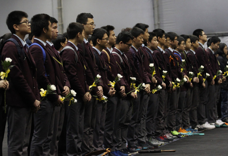 Photo - High school students pay tribute to the victims of the sunken ferry Sewol at a group memorial altar in Ansan, south of Seoul, South Korea, Tuesday, April 29, 2014. South Korean President Park Geun-hye apologized Tuesday for the government's inept initial response to a deadly ferry sinking as divers fought strong currents in their search for nearly 100 passengers still missing nearly two weeks after the accident.(AP Photo/Ahn Young-joon)