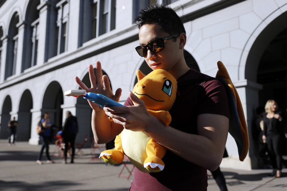 "Photo - Tim C., who did not want to give his last name, searches for Pokemon during a gathering of ""Pokemon Go"" players Wednesday, July 20, 2016, in San Francisco.(AP Photo/Marcio Jose Sanchez)"