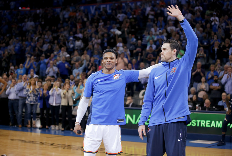 Photo - Oklahoma City's Russell Westbrook , left, speaks to the crowd beside Nick Collison before an NBA basketball game between the Oklahoma City Thunder and the Memphis Grizzlies at Chesapeake Energy Arena in Oklahoma City, Wednesday, April 11, 2018. Photo by Bryan Terry, The Oklahoman
