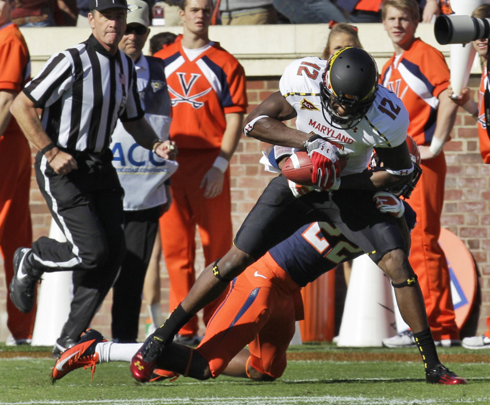 Photo -   Maryland wide receiver Kevin Dorsey (12) hauls in a pass as Virginia cornerback Drequan Hoskey (22) makes the tackle during the first half of an NCAA college football game in Charlottesville, Va., Saturday, Oct. 13, 2012. (AP Photo/Steve Helber)