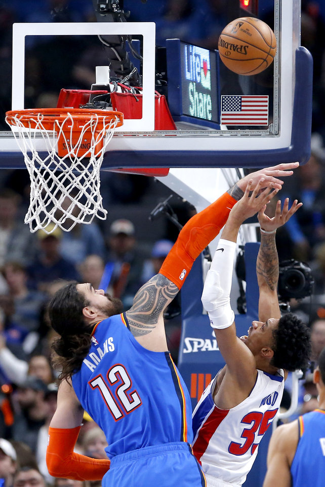 Photo - Oklahoma City's Steven Adams (12) defends against Detroit's Christian Wood (35) during NBA basketball game between the Oklahoma City Thunder and the Detroit Pistons at the Chesapeake Energy Arena in Oklahoma City, Friday, Feb. 7, 2020.  [Sarah Phipps/The Oklahoman]