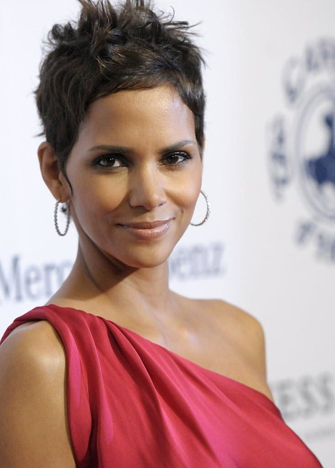 Photo - Women with pixie cuts who want a different look for the holidays could add some styling product to create a softly spiked, more edgy look like Halle Berry's. AP Photo.
