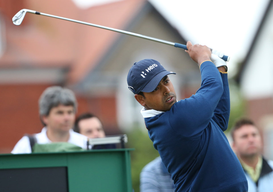 Photo - Anirban Lahiri of India plays a shot off the 3rd tee during a practice round ahead of the British Open Golf championship at the Royal Liverpool golf club, Hoylake, England, Wednesday July 16, 2014. The British Open Golf championship starts Thursday July 17. (AP Photo/Scott Heppell)