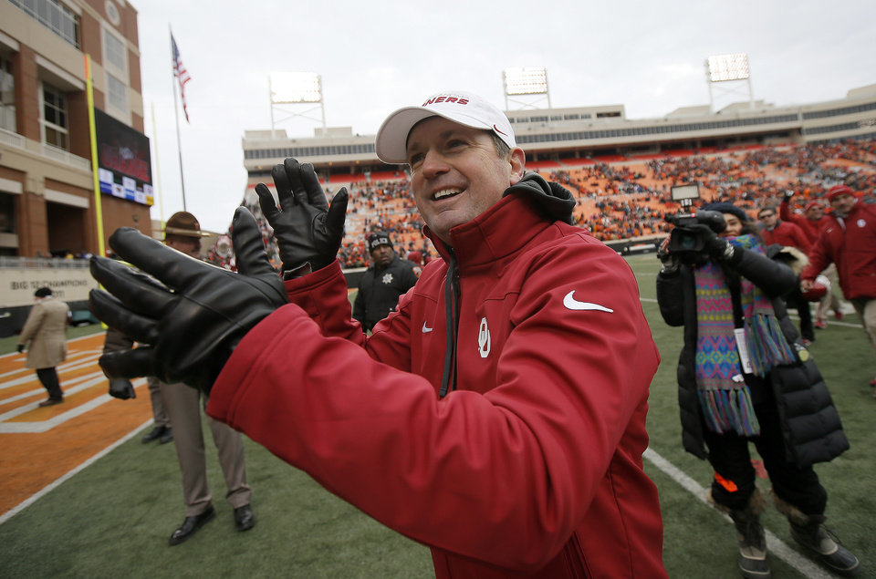 Photo - Oklahoma coach Bob Stoops smiles after  the Bedlam college football game between the Oklahoma State University Cowboys (OSU) and the University of Oklahoma Sooners (OU) at Boone Pickens Stadium in Stillwater, Okla., Saturday, Dec. 7, 2013. Oklahoma won 33-24. Photo by Bryan Terry, The Oklahoman