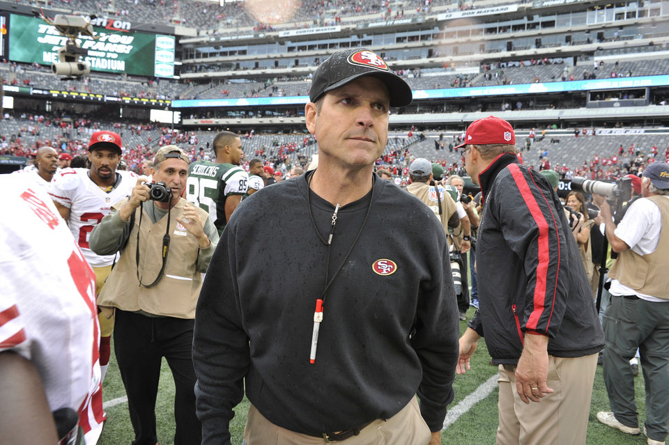 San Francisco 49ers head coach Jim Harbaugh leaves the field after an NFL football game against the New York Jets Sunday, Sept. 30, 2012, in East Rutherford, N.J. the 49ers won the game 34-0. (AP Photo/Bill Kostroun)