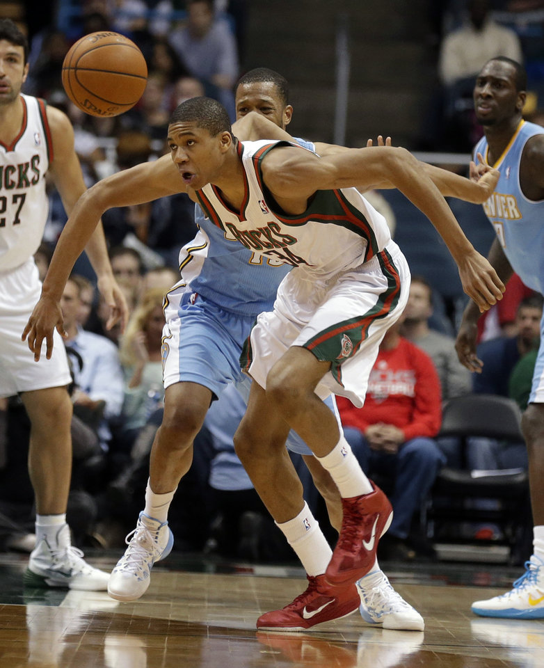 Photo - Milwaukee Bucks' Giannis Antetokounmpo (34) eyes a loose ball against the Denver Nuggets during the second half of an NBA basketball game Thursday, Feb. 20, 2014, in Milwaukee. (AP Photo/Jeffrey Phelps)