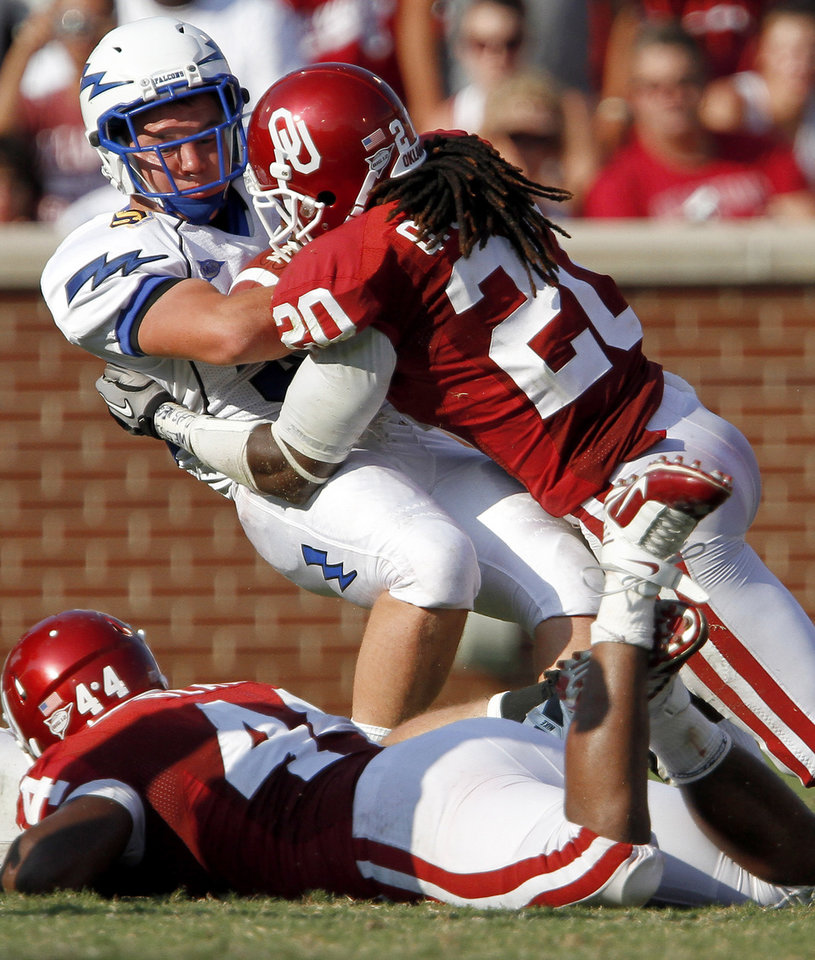 Photo - OU's Quinton Carter hits Nathan Walker of Air Force during the second half of the college football game between the University of Oklahoma Sooners (OU) and Air Force (AF) at the Gaylord Family-Oklahoma Memorial Stadium on Saturday, Sept. 18, 2010, in Norman, Okla.   Photo by Bryan Terry, The Oklahoman