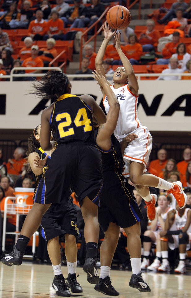 Photo - Oklahoma State's Tiffany Bias (3) shoots a lay up over Coppin State's Dawnnae Roberts (32) and Coppin State's Bria Harris (24)during the women's college game between Oklahoma State University and Coppin State at Gallagher-Iba Arena in Stillwater, Okla.,  Saturday, Nov. 26, 2011.  Photo by Sarah Phipps, The Oklahoman