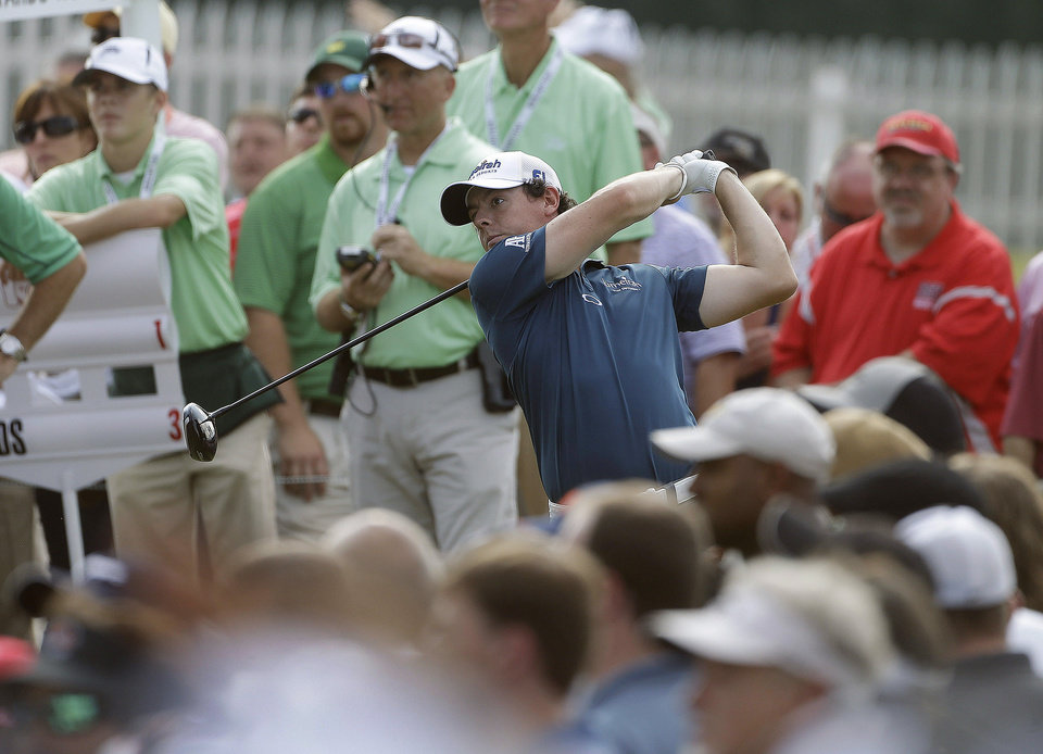 Photo -   Rory McIlroy, of Northern Ireland, hits from the tee on the 13th hole during the first round of the Tour Championship golf tournament in Atlanta on Thursday, Sept. 20, 2012. (AP Photo/John Bazemore)