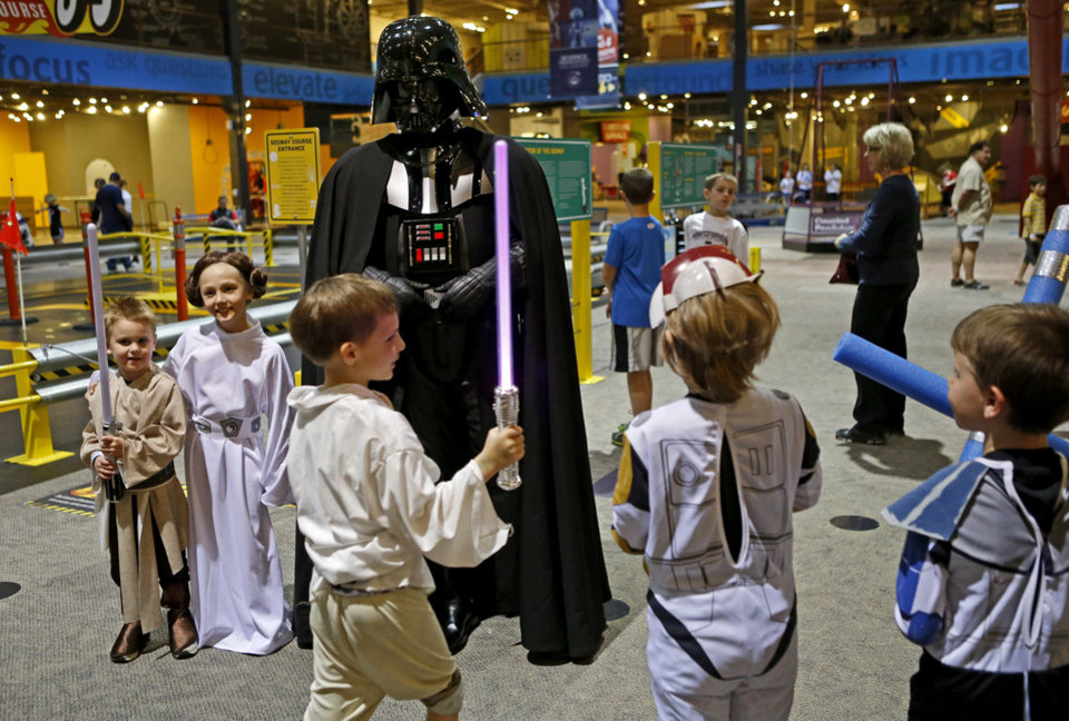 Dressed as Darth Vader, Shawn Lippe, of Oklahoma City, attracts a crowd of children during  Science Museum Oklahoma's Bright Night of Star Wars sleepover. Photo by Bryan Terry, The Oklahoman <strong>Bryan Terry - THE OKLAHOMAN</strong>